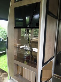 RV home bar - still figuring out how to secure the glass items in an open bar.