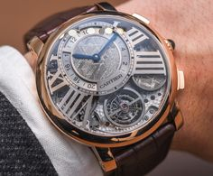 Hands-On: Cartier Rotonde De Cartier Earth And Moon Watch Hands-On - by Kenny Yeo - More on the Rotonde that actually features two meteorite discs at aBlogtoWatch.com