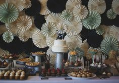 Paper fan backdrop   Photo by Lime Green Photography   100 Layer Cake