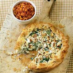 Feta and spinach free-form pie with tomato relish recipe. This vegetarian dish has a gorgeous filling of spinach, cheeses, pine nuts and raisins, an ideal centerpiece to a vegetarian menu.