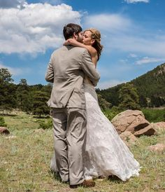 What a romantic image of this bride and groom! A gorgeous Rocky Mountain wedding at Twin Owls Steakhouse in Estes Park, CO. We love how beautiful and green the Black Canyon Inn is during those warm summer months.