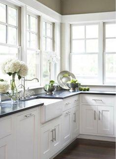 Love the dark benchtop over white cabinets...love the hydrangeas! Kitchen Plans - Home and Garden Design Ideas