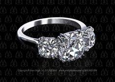 Three stone ring with three antique cushion diamonds