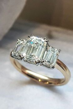27 Eye-Catching Emerald Cut Engagement Rings ❤️ See more: http://www.weddingforward.com/emerald-cut-engagement-rings/ #wedding #emeraldcutengagementrings