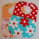 . Bibs make great homemade gifts for baby and any mom will tell ya…they are a must-have! All kinds of designs to choose from: back snap or velcro closure, side closure, back ties, and even pullovers, all so easy to make. Materials vary from pretty cotton prints to