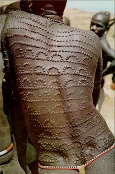 Africa | tribal scarification, Sudan. Body modification: adapting to cultural notions of beauty.
