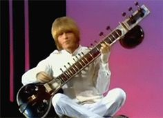 Brian Jones with the Rolling Stones performing Paint it Black in1966 on the Ed Sullivan show. Effortlessly cool and as always ahead of the pack.