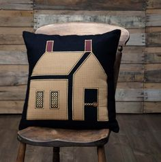 FEATURES* Mustard plaid house appliqued on black felt base with cross stitch and wooden button details* chimneys in burgundy plaid fabric* Each applique outline