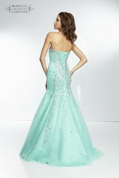 A stunning beaded tulle fishtail gown with corset tie back by Mori Lee.