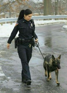 Identification: the uniform helps identify that this is a police officer. Military Working Dogs, Military Dogs, Military Women, Police Dogs, Military Police, State Police, K9 Officer, Female Police Officers, Female Cop