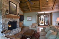 The combination of a stone fireplace and a wood ceiling is wonderful here