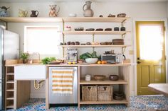 A small kitchen with a custom counter with cubbies for kitchen fixtures, appliances and cookware: A Revived Echo Park Kitchen, Budget Edition. Kitchen On A Budget, New Kitchen, Kitchen Ideas, Small Kitchen Decorating Ideas, Spanish Kitchen, Minimal Kitchen, Kitchen Updates, Kitchen Small, Updated Kitchen