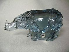 The majestic strength of the Rhino characterizes the visual impact of this Paul Hoff sculpture for the World Wildlife Fund. The piece was made by Reijmyre of Sweden in 1984 and was a limited edition o. Kosta Boda, Rhinoceros, Mint, Sculpture, Crystals, Rhinos, Sculpting, Crystal, Statue
