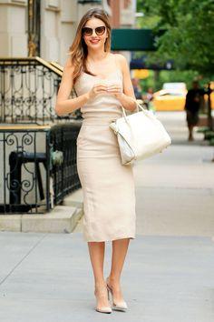Miranda Kerr chic in a Max Mara midi length slim dress in light camel #StreetStyle