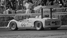Jim Hall drives his Chaparral 2E, chassis 2E-001 to 2nd place behind teammate Phil Hill in chassis 2E-002 at Laguna Seca, 1966. From rolling off the trailers, the 2Es dominated the Can-Am field that weekend. For once, nothing broke... William Hewitt photo.