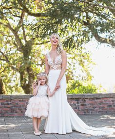 Bride in Cutout Gown with Flower Girl  Photography: Joy Marie Photography Read More: http://www.insideweddings.com/weddings/fairy-tale-outdoor-summer-wedding-at-a-vineyard-in-wine-country/1104/