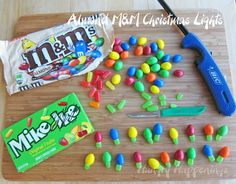 "Quick and easy M&M and Mike and Ike Christmas Lights - top cake/cupcakes and draw a thin ""wire"" to connect"