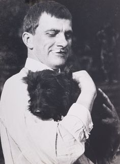 Gelatin silver print of Vladimir Vladimirovich Mayakovsky (1893-1930) and Kotik, the Scottie, by Alexander Rodchenko (1924). Story goes that  Mayakovsky arrived one late afternoon, when there was little light, which is why the shot was taken outdoors. Kotik, loved ice-cream, and had eaten everything that Mayakovsky had bought, which is why the poet is holding him in his arms like a baby.
