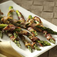 Bacon-Wrapped+Asparagus...bacon makes everything more delicious :)