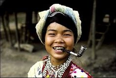 Karen girl with gold teeth and silver pipe. Ma Hong Song, Northern Thailand. ©.Jørgen Flemming