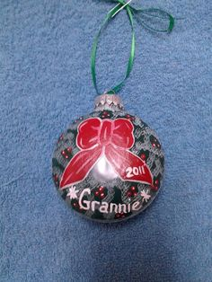 Handpainted Holiday Wreath Ornament by howsheseesitecwood on Etsy, $9.95  Made to order with 2013 year on it.