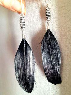Mooi lange oorbellen met veren