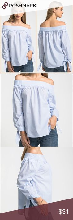 Off The Shoulder Tie Sleeve Poplin Top Light Blue Lightweight off the shoulder tie sleeve poplin top. Beautiful light blue color. Model is wearing size Small.  100% cotton for comfortable wear. Perfect for the warmer months, the office, a night out and vacation!  Available in sizes Small, Medium and Large. Tops Blouses
