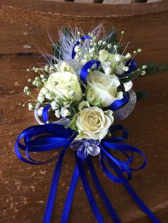 White spray rose with navy & silver ribbon, feathers, and a little bling prom corsage