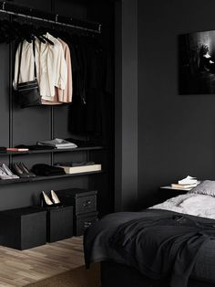 Deep charcoal bedroom walls and built-in closet storage system. http://jensen-beds.com/ - like this