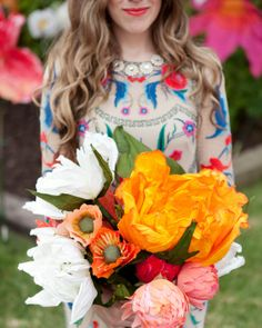 The sister of the bride (the one and only @Brittany Jepsen   The House That Lars Built!) handmade the bride's bouquet, which was intended to look as though the blooms were plucked from an oversized garden. View more of this colorful DIY wedding online!