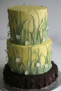"""Skinny Grass-    for an outdoorsy couple into hiking, camping and canoeing. cake serves approx 140 with double tall tiers. """"bark"""" on the base is all chocolate fondant. grass design from a magazine clipping the bride cut out... not sure which magazine though."""