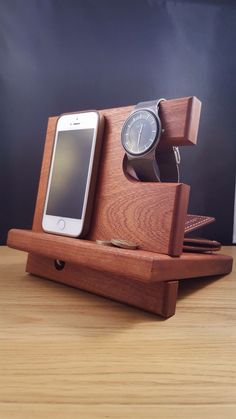 Movile phone, watch valet stand made from solid sapele hardwood.