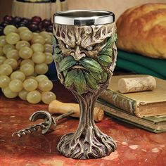 In the spirit of the Green, lift your very own Medieval tree ent-embellished goblet to toast the changing seasons or any other special occasion. The amazingly detailed, quality designer resin work boasts intricate artwork wrapped around a removable, dishwasher-safe, 8 oz. stainless steel insert.Resin wrapped stainless steel bowlHolds 8oz