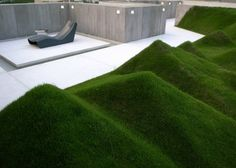Undulating lawn is on the terrace of a penthouse called Axial Symphony in Shenzhen, China. Studio Design Systems,