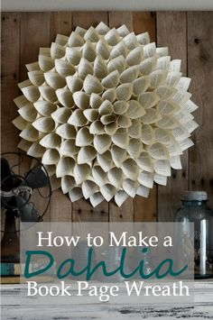 How to make a Dahlia book page wreath - A Wonderful Thought Spray paint cones gold, red, silver, green; glue small xmas ball in some cones, or some fake holly / evergreen sprigs? Dahlia book page wreath Old Book Crafts, Book Page Crafts, Book Page Art, Old Book Pages, Paper Dahlia, Paper Flowers, Book Page Flowers, Dahlia Flowers, Diy Flowers