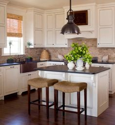 White cabinets black granite