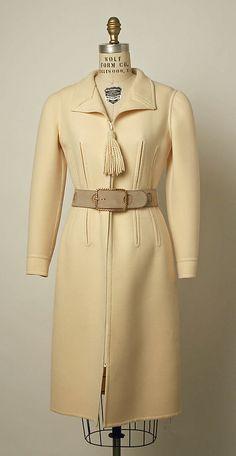 Coat Valentino (Italian, born 1932)  Date:     fall/winter 1970–71 Culture:     Italian Medium:     wool, suede, synthetic, snakeskin Dimensions:     (a) L. at center back 41½ in. (105.5 cm) (b) L. 35¾ in. (90.8 cm)