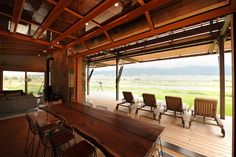 Prefab Loft Homes |I absolutely love the clear garage door!  thats what i want for our house!  In montana a prefab home by medicine hat with sliding barn doors