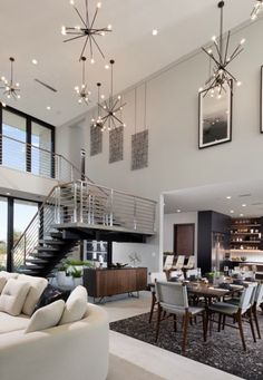 These space-aged Astra chandeliers look stars in this luxury living room interior design from the 2020 New American Home project. An iconic fixture, Astra features an organic, asymmetrical design. Ideal for dining room settings or entryways, these space-aged inspired pieces are so versatile they can be incorporated into a variety of interiors. #livingroom #livingroomdecor #livingroomdesign #interiordesign #livingroomstyle #chandeliers #homedecor #luxury #luxe #luxurylifestyle…