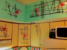 Kitchen Cabinets - stick art with candy canes and starbursts  - oelectricmayhemo
