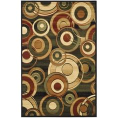 This floor rug displays a stunning panel of green, rust, beige and ivory over a black background.