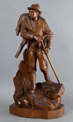 impressive carved wood poacher statue with game, huggler brienz ca. 1880