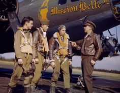 """Crew Members of B-17F Fortress """"Mission Belle"""" of the 342nd Bomb Squadron listen to a word from the Chaplain, James O. Kincannon, at Polebrook Air Base, late 1944."""