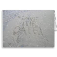 Save the date card, written in the sand