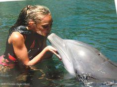 Kiss a dolphin