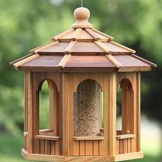 Our magnificent hanging cedar gazebo seed feeder will bring hours of bird-watching enjoyment. The Western Red Cedar gazebo bird feeder is available in two sizes: 8-sided Octagon and 6-sided Hexagon styles. FREE SHIPPING!!! www.cedarshed.com #cedarshed #cedar #woodworking #birds #birdhouse #birdfeeder #gardening #garden #landscaping
