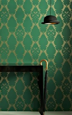 Boxing Hares Wallpaper A clever trellis design of hares boxing, in gold on green.