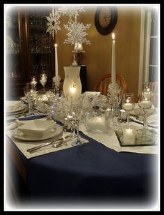 winter table with candles, mirrors, crystal