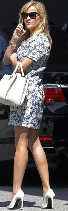 Who made  Reese Witherspoon's white pumps, blue print dress, and tote handbag?