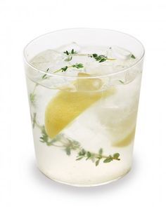 Tequila-Thyme Lemonade  3 thyme sprigs  1 teaspoon superfine sugar  2 lemon wedges  3 ounces silver tequila  1 ounce cold water  Ice